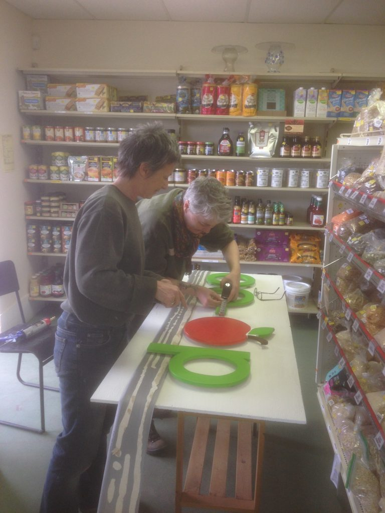 Volunteers Chris and Tanya creating the Co-op sign